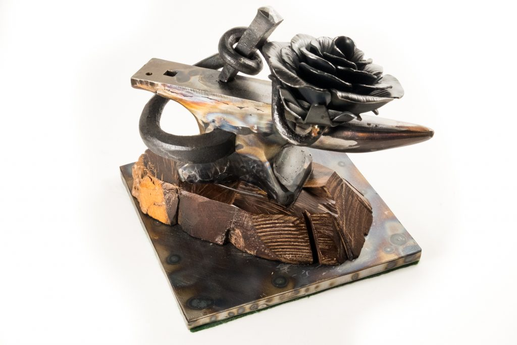 Back view of 'Forgery', a welded mild steel sculpture for an anvil and flower by Jim Davis