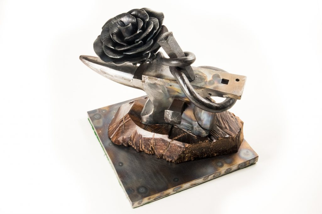 Forgery, a welded mild steel sculpture for an anvil and flower by Jim Davis